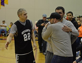 Metlakatla's Archie Dundas (22) and Willie Hayward congratulate Klukwan's Stuart DeWitt after he was announced to the Gold Medal Hall of Fame at the Juneau Lions Club 71st Annual Gold Medal Basketball Tournament at Juneau-Douglas High School on Friday. (Photo courtesy Klas Stolpe)