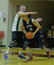 Angoon's Marti Fred (10) is defended by Sitka's Norm Staton during their Masters Bracket game of the Juneau-Lions Club 71st Annual Gold Medal Basketball Tournament at Juneau-Douglas High School on Monday. Angoon won 65-56. (Photo courtesy Klas Stolpe)