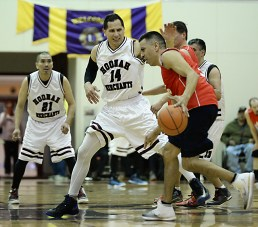 Hoonah's Greg Garcia (14) defends Kake's Jay Peterson during their Masters Bracket game at the Juneau-Lions Club 71st Annual Gold Medal Basketball Tournament at Juneau-Douglas High School on Monday. Hoonah won 80-66. (Photo courtesy Klas Stolpe)