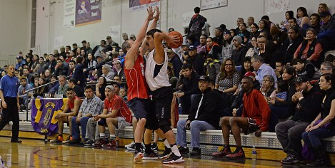 Kake's Keith Nelson defends Angoon's Edward Jack during their Masters Bracket elimination game in the Juneau Lions Club 71st Annual Gold Medal Basketball Tournament at Juneau-Douglas High School on Friday. Kake won 94-67. (Photo courtesy Klas Stolpe)