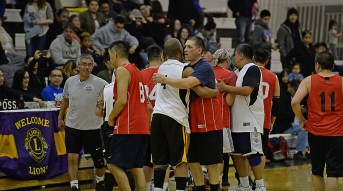 Angoon and Kake players congratulate each other after their Masters Bracket elimination game in the Juneau Lions Club 71st Annual Gold Medal Basketball Tournament at Juneau-Douglas High School on Friday. Kake won 94-67. (Photo courtesy Klas Stolpe)