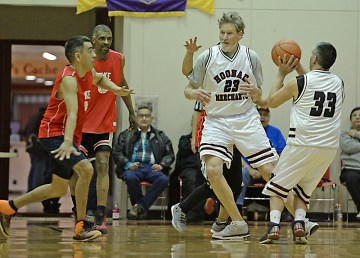 Hoonah's Albert Hinchman (33) sets to shoot of a screen by Pete Schneeberg (23) during the Master's Bracket championship of the Juneau Lions Club 71st Annual Gold Medal Basketball Tournament at Juneau-Douglas High School on Saturday. Hoonah beat Kake 80-78. (Photo courtesy Klas Stolpe)
