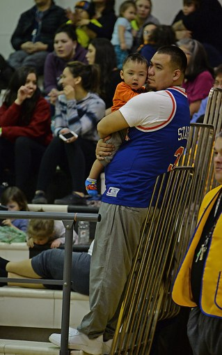 A young fan tries to stay awake during a late game at the Juneau Lions Club 71st Annual Gold Medal Basketball Tournament at Juneau-Douglas High School on Wednesday. (Photo courtesy Klas Stolpe)