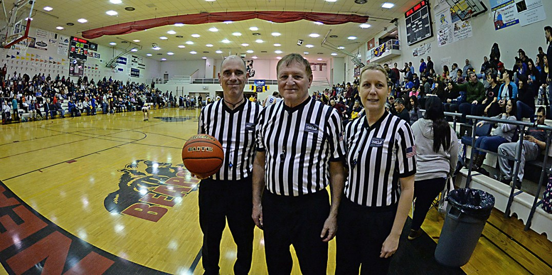 Officials Erik Johnson, Joe Thompson, and Rae Ann Johnson during the C-Bracket championship of the Juneau Lions Club 71st Annual Gold Medal Basketball Tournament at Juneau-Douglas High School on Saturday. (Photo courtesy Klas Stolpe)