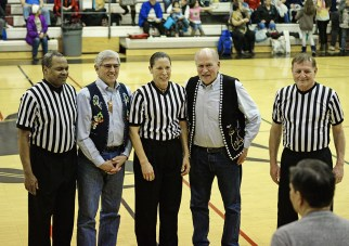 Referee Manuel Fernandez, Lt. Governor Byron Mallott, referee Suzanne DePoe, Governor Bill Walker and referee Joe Thompson at the Juneau Lions Club 71st Annual Gold Medal Basketball Tournament on Monday. (Photo courtesy Klas Stolpe)