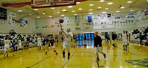 Klukwan and Filcom C-bracket teams warm up for the start of winners pool play at the Juneau Lions Club 71st Annual Gold Medal Basketball Tournament on Monday at Juneau-Douglas High School (Photo courtesy Klas Stolpe)