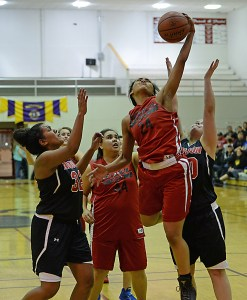 Hoonah's Taryn White (24) rebounds against during their Womens Bracket elimination game in the Juneau Lions Club 71st Annual Gold Medal Basketball Tournament at Juneau-Douglas High School on Wednesday. Hoonah won 47-45. (Photo courtesy Klas Stolpe)