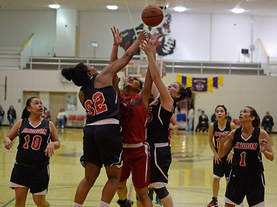 Angoon's Tasha Hueman (32) and Roxann Braley (15) battle for a rebound with Hoonah's Taryn White (24) during their Womens Bracket elimination game in the Juneau Lions Club 71st Annual Gold Medal Basketball Tournament at Juneau-Douglas High School on Wednesday. Hoonah won 47-45. (Photo courtesy Klas Stolpe)