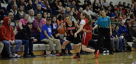 Angoon's Carmaleeda Estrada (1) dribbles around Hoonah's Alice Johnson (5) during their Womens Bracket elimination game in the Juneau Lions Club 71st Annual Gold Medal Basketball Tournament at Juneau-Douglas High School on Wednesday. Hoonah won 47-45. (Photo courtesy Klas Stolpe)