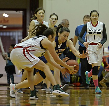 Hoonah's LaDonna Johnson and Yakutat's Lorena Williams go for a loose ball during their Womens Bracket elimination game in the Juneau Lions Club 71st Annual Gold Medal Basketball Tournament at Juneau-Douglas High School on Friday. Hoonah won 56-53. (Photo courtesy Klas Stolpe)