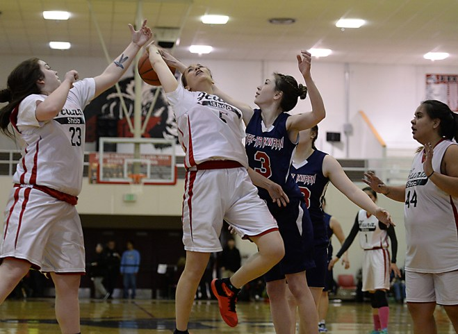 Hoonah's Alice Johnson (5) is fouled by Yakutat's Katrina Fraker (3) during their Womens Bracket elimination game in the Juneau Lions Club 71st Annual Gold Medal Basketball Tournament at Juneau-Douglas High School on Friday. Hoonah won 56-53. (Photo courtesy Klas Stolpe)