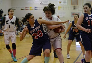 Yakutat's Jasmine James (30) and Hoonah's Mariah Martin battle for a rebound during their Womens Bracket elimination game in the Juneau Lions Club 71st Annual Gold Medal Basketball Tournament at Juneau-Douglas High School on Friday. Hoonah won 56-53. (Photo courtesy Klas Stolpe)