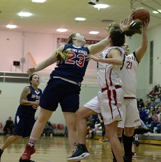 Yakutat's Janie Jensen (23) and Hoonah's LaDonna Johnson and Brenna Johanson (21) battle for a rebound during their Womens Bracket elimination game in the Juneau Lions Club 71st Annual Gold Medal Basketball Tournament at Juneau-Douglas High School on Friday. Hoonah won 56-53. (Photo courtesy Klas Stolpe)