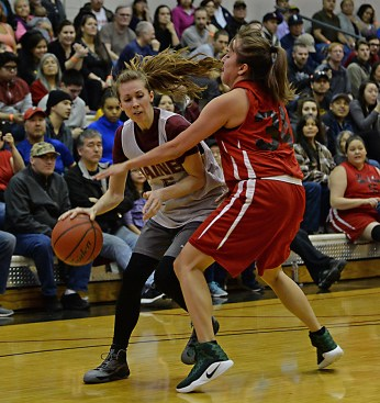 Haines' Lisa Shove (5) is defended by Hoonah's Ladonna Johns (34) during their Women's Bracket game of the Juneau Lions Club 71st Annual Gold Medal Basketball Tournament at Juneau-Douglas High School on Tuesday. Haines won 62-55. (Photo courtesy Klas Stolpe)