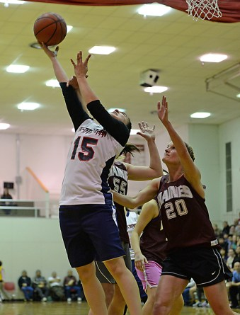 Yakutat's Lorena Williams (15) scores against Haines' Alisa Beske (55) and Sarah Elliott (20) during their Womens Bracket semifinal in the Juneau Lions Club 71st Annual Gold Medal Basketball Tournament at Juneau-Douglas High School on Thursday. Haines won 65-52. (Photo courtesy Klas Stolpe)
