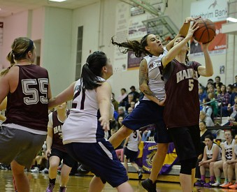 Haines' Lisa Shove (5) is fouled by Yakutat's Kim Buller during their Womens Bracket semifinal in the Juneau Lions Club 71st Annual Gold Medal Basketball Tournament at Juneau-Douglas High School on Thursday. Haines won 65-52. (Photo courtesy Klas Stolpe)
