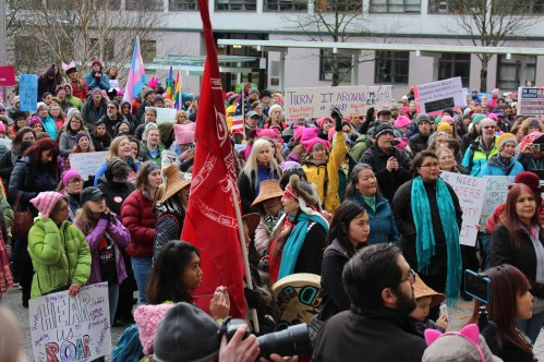 Protesters gather at the steps of the Alaska State Capitol on Jan. 20, 2018 for the Women's March on Juneau. (Photo by Adelyn Baxter/KTOO)