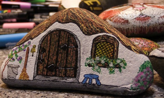 A rock painted like a tiny house by Heather Stemmerman (Photo by David Purdy/KTOO)
