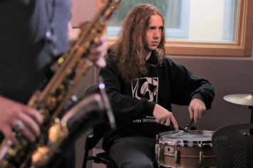 Zach Lawhorne (sax) and Vaughn Gallagher (drums) on Juneau Afternoon 3/13/2019. The bandathon begins this Saturday at TMHS. (Photo by David Purdy/KTOO)