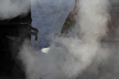 Mushers get their hot water from modified oil drums in Nikolai. (Photo by Zachariah Hughes/Alaska Public Media)