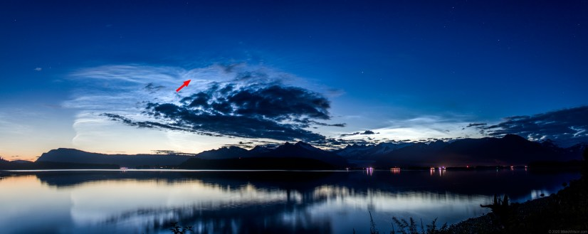 """Panoramic composite photo from north Douglas at about 12:40 am on Thursday July 16, 2020. The comet C/2020 F3 (NEOWISE) """"NEOWISE"""" is visible among noctiluminescent clouds just above and to the left of the darker clouds, as indicated by the red arrow. Image has been adjusted to enhance contrast. (Photo by Mikko Wilson/KTOO)"""