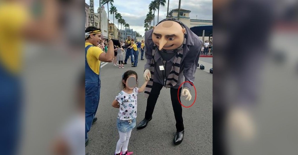 Families sue Universal Orlando after actor made white-power 'OK' gesture posing with girls
