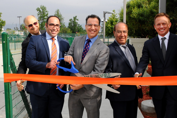 CANOGA PARK, CA - MAY 16: Metro officials join L.A. City Council Member Bob Blumenfield and the Warner Center Association to conduct a ribbon cutting for the grand opening of a new pedestrian station entrance at the Canoga Metro Orange Line Station on May 16, 2016 in Canoga Park, California.