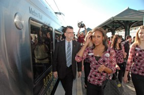 Metrolink Chairman RIchard Katz escorts Rose Queen Drew Helen Washington and Royal Court to Gold Line train for a ride to Heritiage Square Station.