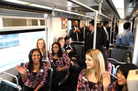 Rose Queen Drew Helen Washington, at left, and Royal Court on board Gold Line train to Pasadena.