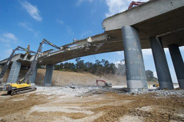 Tearing down the north side of the Mulholland Bridge. Photo by Gary Leonard for Metro.