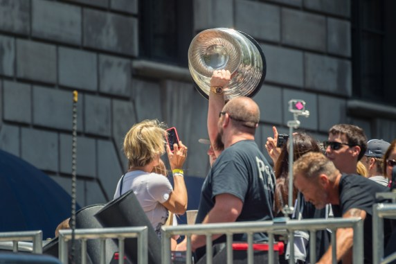 Whoops -- I was on wrong side of the street to get a good view of the Stanley Cup. I think that's goalie Jonathan Quick holding it.