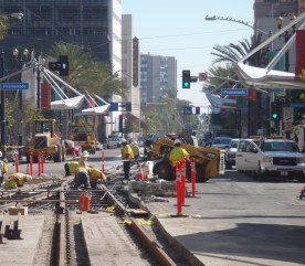 Workers installing new tracks as part of the Better Blue Line project in downtown Long Beach in October. Photo by Anna Chen/Metro.