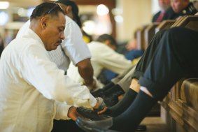 """""""Shoeshine"""" David Trejo plying his trade at the new shoeshine stand that opened in Union Station in late October. Photo by Steve Hymon/Metro."""