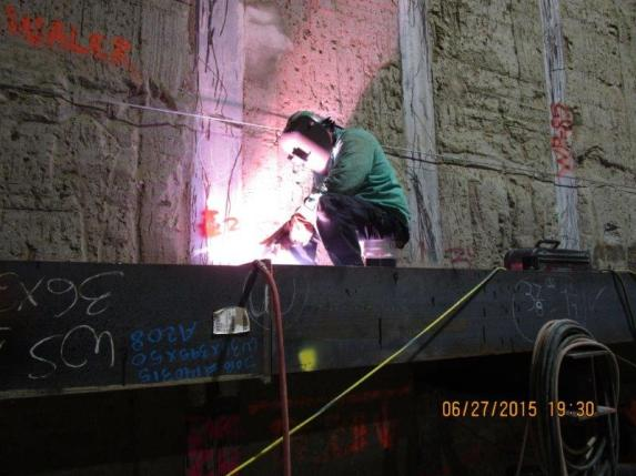EXPOSITION STATION – Welding Tier 2 bracing along the west wall south of station