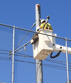 Crews at work on the Gold Line's overhead power supply system this afternoon.