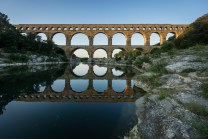 A 2,000-year-old aqueduct in Pont du Gard, France. Photo by Gordon, via Flickr creative commons.