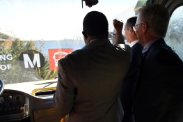 Metro Board Members (from left) Mark Ridley-Thomas, Eric Garcetti and Paul Krekorian as the bus breaks through the banner this morning.