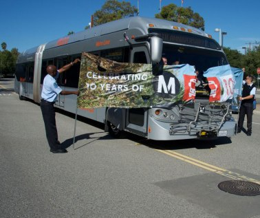 65-foot Metro Liner Bus rips through 10th anniversary banner at Sepulveda Orange Line Station.