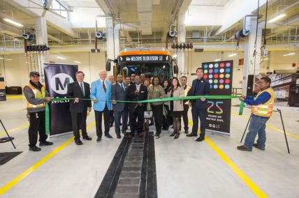 Cutting the ribbon at Division 13. Photo by Gary Leonard for Metro.