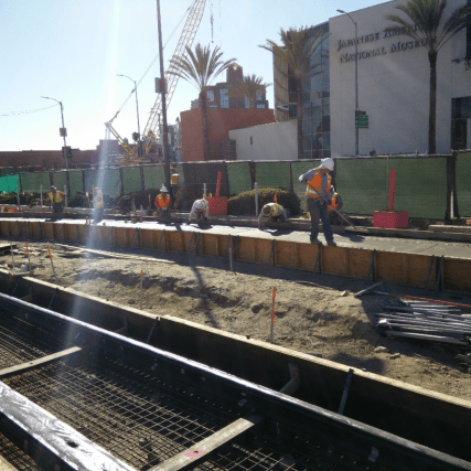 Crews working to complete concrete encasement of the shoofly track tie-in to Little Tokyo/Arts District Station.