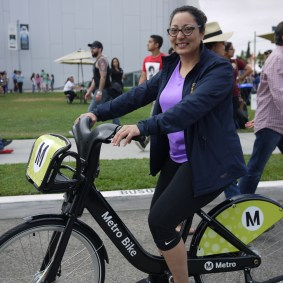 California State Assemblymember Christina Garcia tries out Metro Bike Share.
