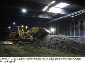 C1045.170310.320pm, loader moving muck at La Brea under deck Orange Dr, looking SE