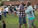 NAACP Minneapolis President Jason Sole (left) greets Pastor Danny Givens