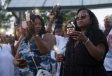 Allysza Castile (left) the sister of Philando Castile and Valerie Castile (right) the mother of Philando hold candles in his honor.