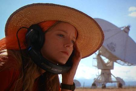Jodie Foster's character from the film Contact listens to a headset at the Very Large Array.