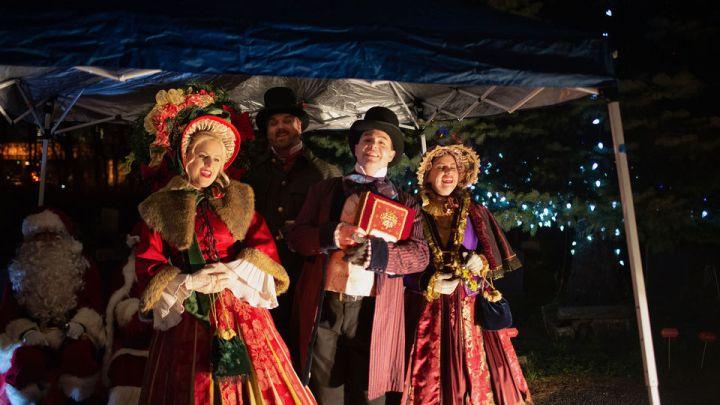 Yuletide Carolers usher in holiday season during tree lighting at Harsimus Cemetery (PHOTOS)