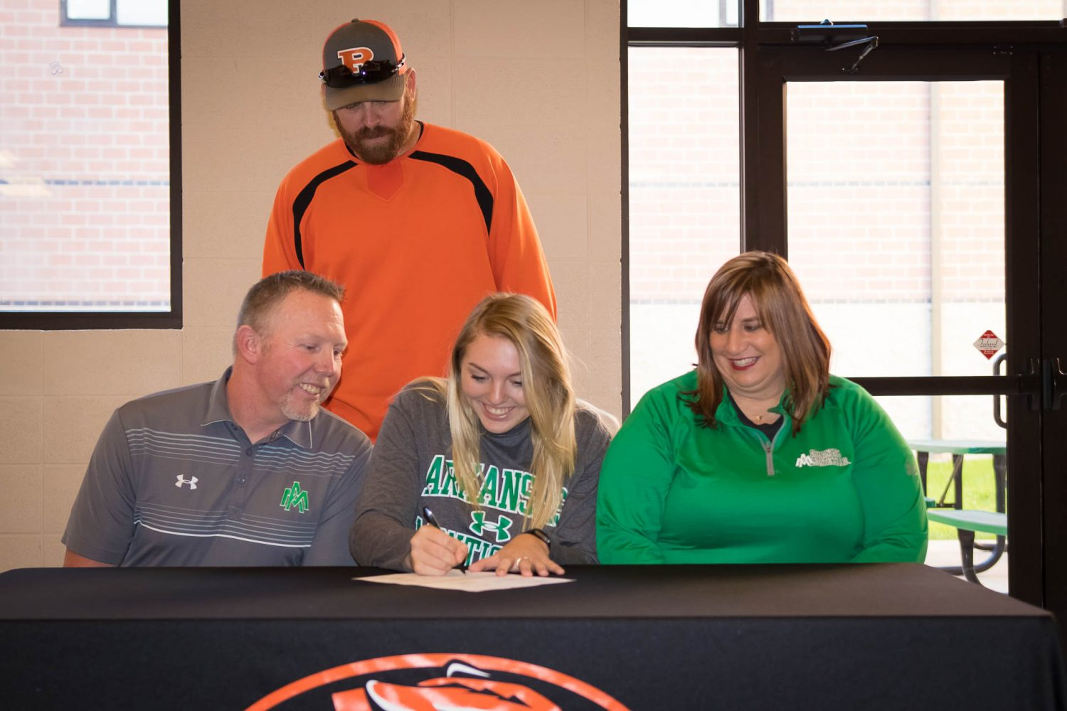 Stolte Steps Up To College Softball