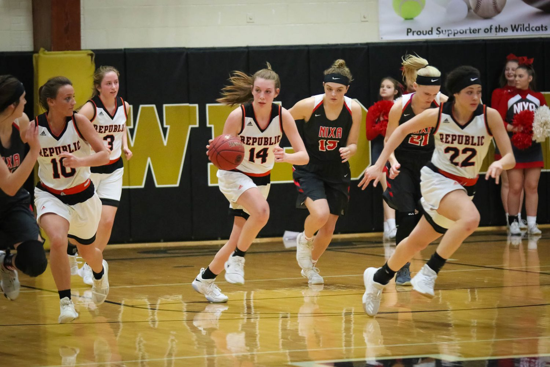 Photos: Varsity Girls Basketball Vs Nixa (Districts)