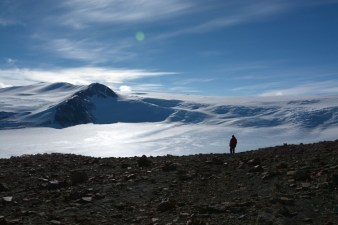 A person standing in an Antarctic landscape.