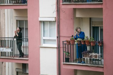 two people on a balcony